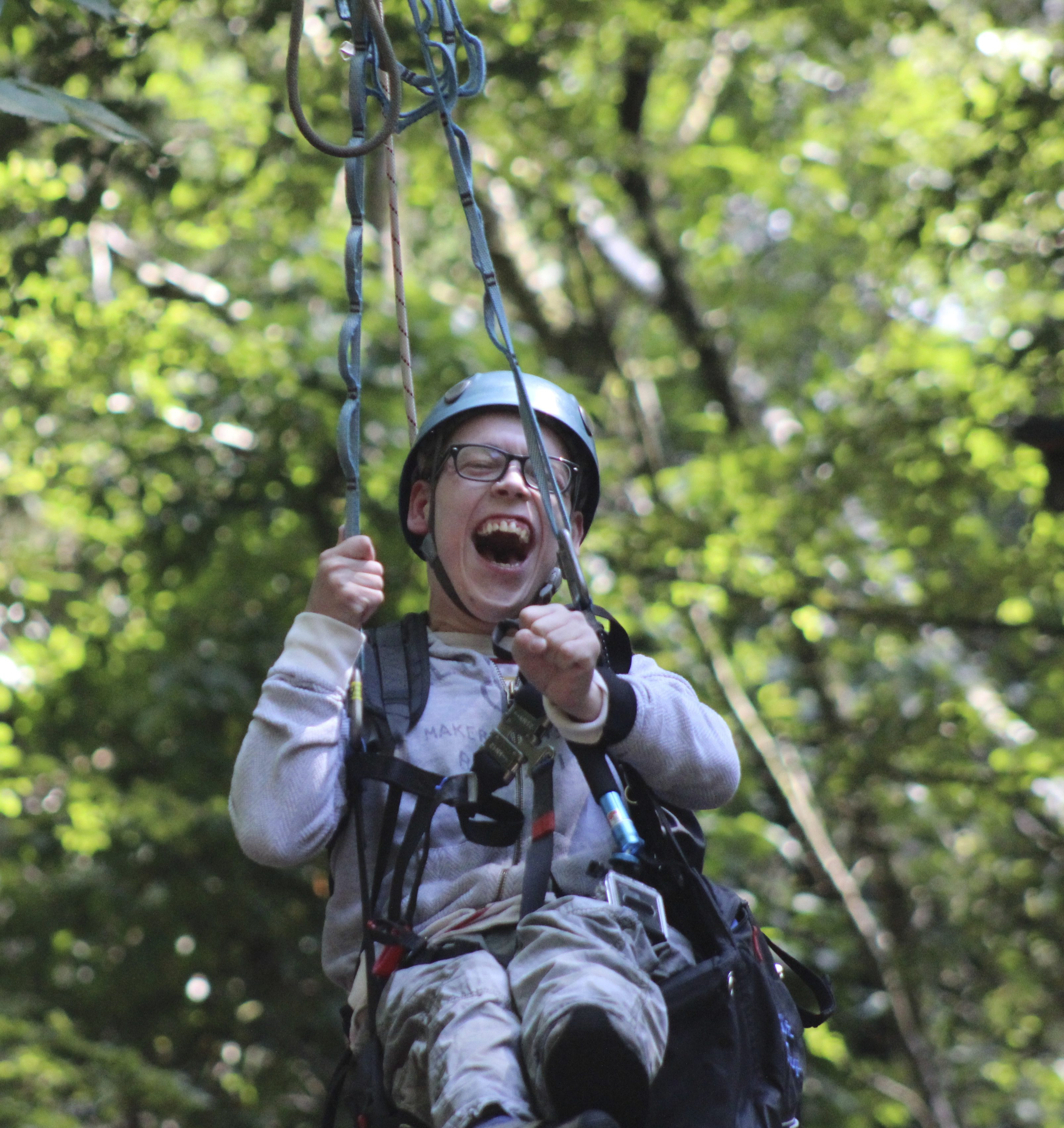 boy-on-zip-for-inclusion-bids
