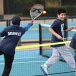 Young people playing tennis at 2016 Festival