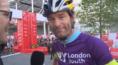 Mark Webber at start line in helmet and london youth top