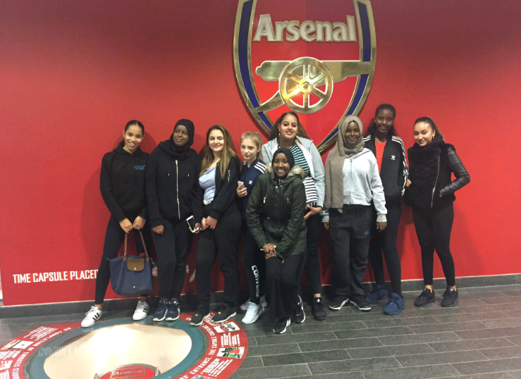 KTCC girls stood by arsenal FC logo