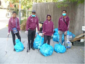 group of young people cleaning up nature